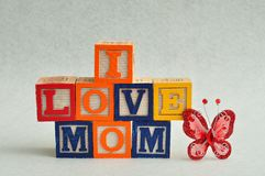 I love mom spelled with colorful alphabet blocks Stock Images