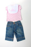 I love mommy baby clothes. Pink T-shirt, blue jeans and bib Royalty Free Stock Photos