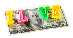 I love money - 100 dollars, isolated on white. The phrase I love money from plastic letters over one hundred dollar banknote - money concept shot Royalty Free Stock Photos