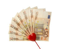 I love money. Red heart over a stack of 50 euro bills, isolated on white Stock Photography