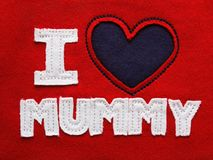 I love mummy over red. Patchwork I love mummy on the red fabric royalty free stock photography