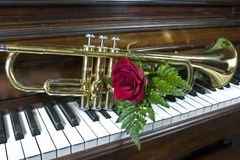 I Love Music. Piano, trumpet and a red rose Stock Photos