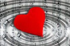 I love music!. A red heart over a music sheet with ripples stock illustration