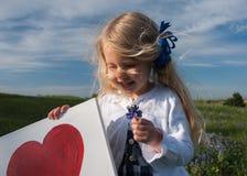 I love my bluebonnet. Little girl in a bluebonnet flower field in Texas royalty free stock photos