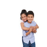 I love my brother. Cheerful mixed-race girl hugging her brother from behind royalty free stock photos