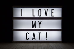 I love my cat!. `I love my cat` text in lightbox Stock Photography