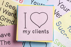 I love my clients written on a note stock photos