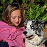 I love my dog. Young girl loving her dog Royalty Free Stock Photo