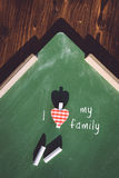 I love my family handwritten. On the green Royalty Free Stock Image