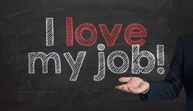 I love my job handwritten with white chalk on a blackboard prese Stock Image