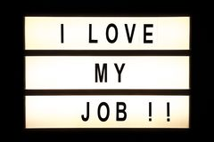 I love my job hanging light box. Sign board royalty free stock images