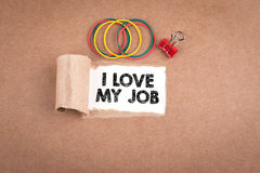I love my job. Inscription in window of  torn paper Royalty Free Stock Images