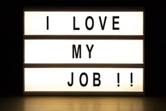 I love my job light box sign board. On wooden table royalty free stock photography