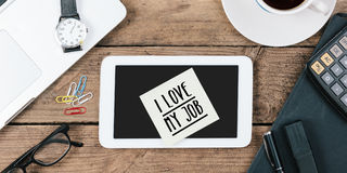 I love my job note on office desktop Royalty Free Stock Images