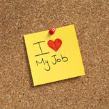 I love my job. Note pinned on cork noticeboard Stock Image