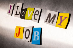 I Love My Job written with color magazine letter clippings on metal background. Design for business and work.  Royalty Free Stock Images