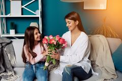 I love my mom! Attractive young woman with little cute girl are spending time together at home.