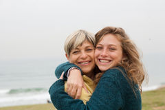 I love my mom so much !. Lovable mom and daughter hugging each other and posing Royalty Free Stock Image