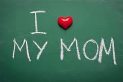I love my mom. Short phrase handwritten on chalkboard Stock Photography