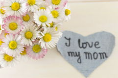 I love my mom written on denim heart Stock Images