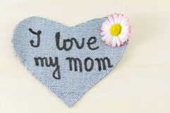 I love my mom written on denim heart Royalty Free Stock Photos