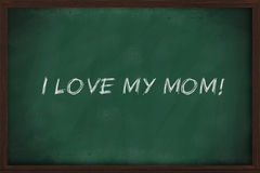 I love my mom. Written on green chalkboard Stock Images
