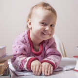 I love my office work. Little beautiful baby girl works with doc. Uments. Humorous Photo Stock Images