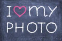 I love my photo. Blackboard with lettering I love my photo stock photos