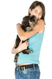 I love my puppy. Pretty owner hugging her puppy royalty free stock photography