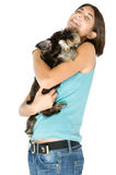 I love my puppy. Pretty owner hugging her puppy royalty free stock photo