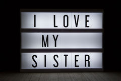 I love my sister. `I love my sister` text in lightbox Royalty Free Stock Photos