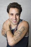 I love my tatoos. Latino man with tattoos portrait Royalty Free Stock Photography