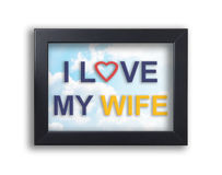 I love my wife text on sky in photo frame Royalty Free Stock Photography