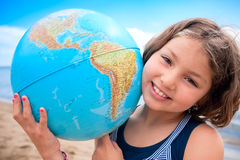 I love my world!. Young girl hugs Earth globe royalty free stock image