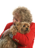 I Love My Yorkie. A woman giving her pet yorkie dog a big hug. Focus is on dog's face Royalty Free Stock Images