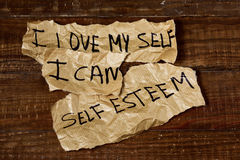 I love myself, I can, self esteem. The text I love myself, I can and self esteem written in some pieces of paper, placed on a rustic wooden surface Royalty Free Stock Images