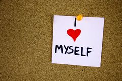 I Love Myself writing on yellow note pinned on cork board background. Stock Photo