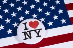 I Love New York. LONDON, UK - APRIL 27TH 2018: An I Love New York badge pictured over the USA flag, on 27th April 2018 stock photos
