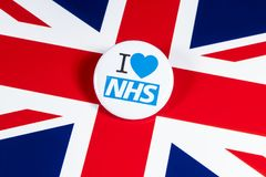 I Love the NHS. LONDON, UK - APRIL 27TH 2018: An I Love the NHS badge over the UK flag, on 27th April 2018.  The The National Health Service was established in Royalty Free Stock Photography