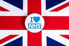 I Love the NHS. LONDON, UK - APRIL 27TH 2018: An I Love the NHS badge over the UK flag, on 27th April 2018.  The The National Health Service was established in Stock Image
