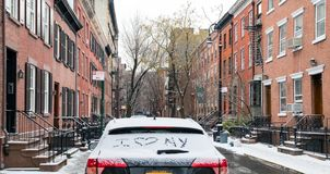 I love NY written in snow on a car parked in New York City. I love NY written in snow on a car parked in the Greenwich Village neighborhood of Manhattan after a stock photo