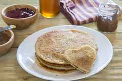 I love pancakes. Heart shaped pancake on stack of pancakes Royalty Free Stock Images