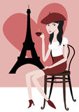 I love Paris. Young Girl sitting in front of the Eiffel Tower drinking an espresso Royalty Free Stock Image