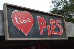 I LOVE PIES !. The chalk board sign says it all, I love pies Royalty Free Stock Images