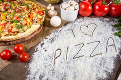 I love pizza written in flour Stock Photo