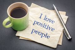 I love positive people note. I love positive people  - handwriting on a napkin with a cup of coffee Royalty Free Stock Image
