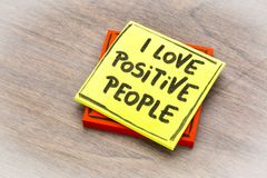 I love positive people note. I love positive people  - handwriting on a sticky note against grained wood Royalty Free Stock Photos