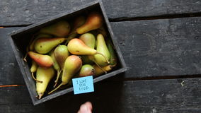 I love real food tag and Pears in wooden box on table. Copy space. stock video footage