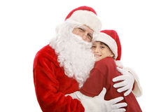 I Love Santa. Santa giving a hug to an adorable little boy.  Isolated on white Stock Photography