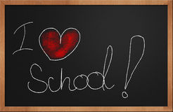 I love school. Written with chalk and red colored heart on a blackboard Stock Photography